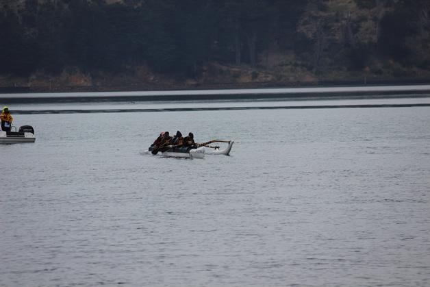 Ōraka Aparima Waka Ama rōpū out on the water.