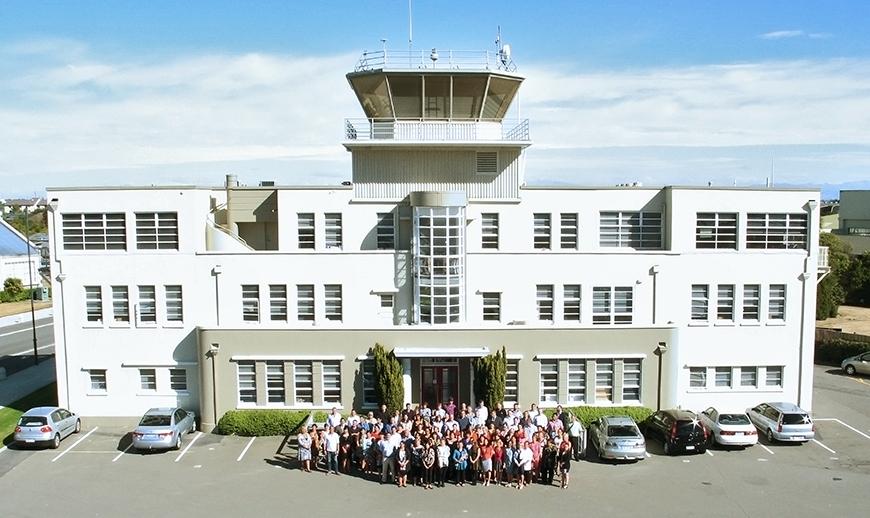 0000Te Rūnanga o Ngāi Tahu staff outside the old Wigram Airbase control tower offices.