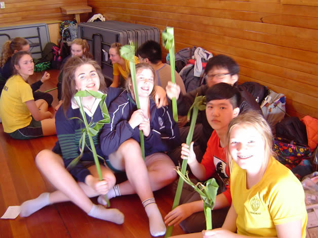 A group of students with their harakeke flowers.