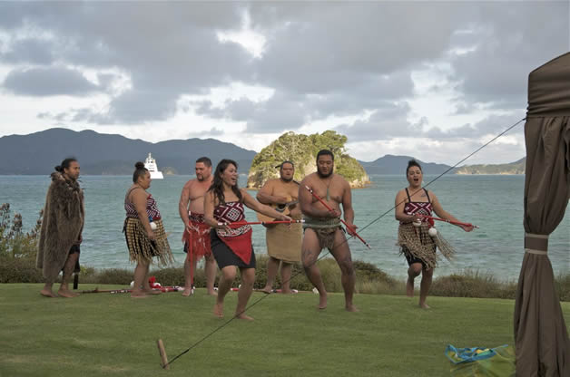 A kapa haka performance on a private island for super-yacht visitors.