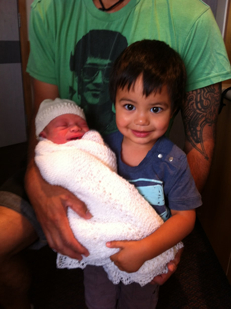 Proud big brother Kahurangi holding his little brother Kaitatea.