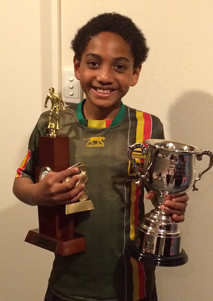 Adama with his football prizes.