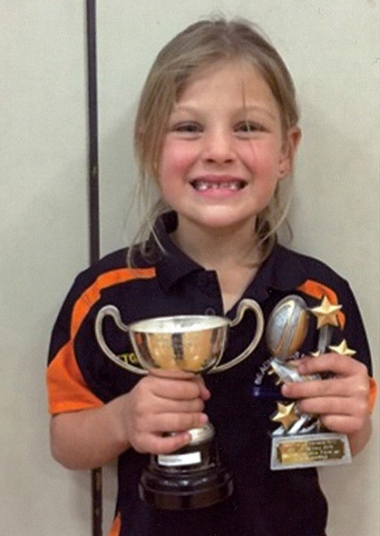 Anaya proudly holding her trophies.