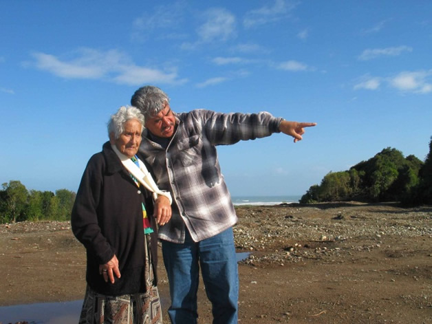 Aunt Tort Tainui (Te Māori Raukawa Tainui) and Uncle Ned Tauwhare standing on the empty Arahura Marae site back when it all started.