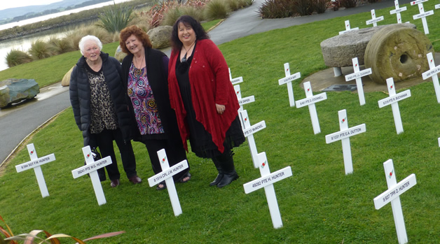 Aunty Jane Davis, Muriel Johnstone and Ann Wakefield, three generations of nieces of the Hunter whānau at the field of crosses.