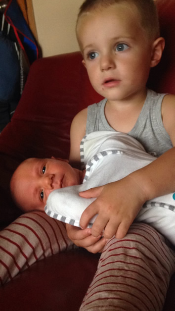 Baby Hektor Wallis with his big brother, William.