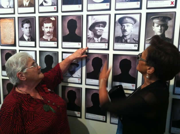 Barbara Vaea and Marie Mahuika pointing out the photo of their Great Uncle, Pahikore (Butler) te Koeti.