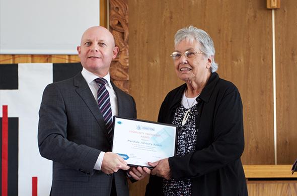 Betty Rickus with the award.