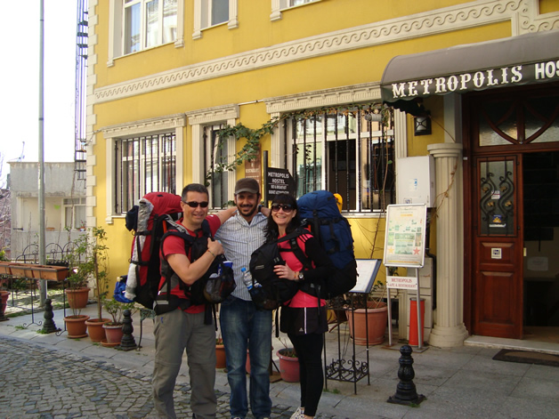 Brent (left) with his wife, Claire Ruru and the hostel owner.