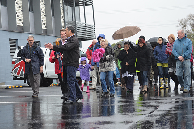 Brett Cowan leading rūnanga members and members of the Kaikōura community.