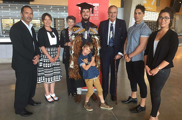 Caley with proud whānau at the graduation ceremony.