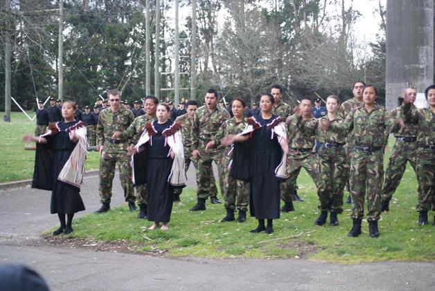 Connagh Wesley (middle, wearing korowai) performing a haka pōwhiri welcoming whānau to Burnham Military Camp.