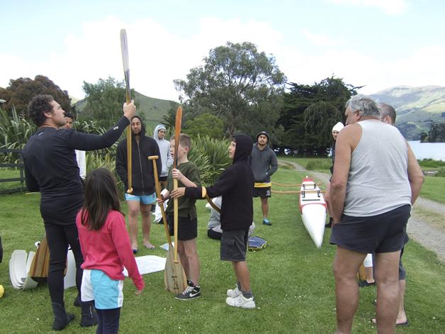 Craig Pauling gives the whānau some paddling tips.