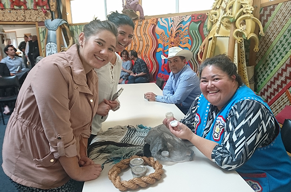 Danielle and Terina Stockwell showing their products to Liz Medicine Crow.