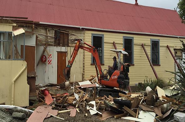Demolition of the old building begins.