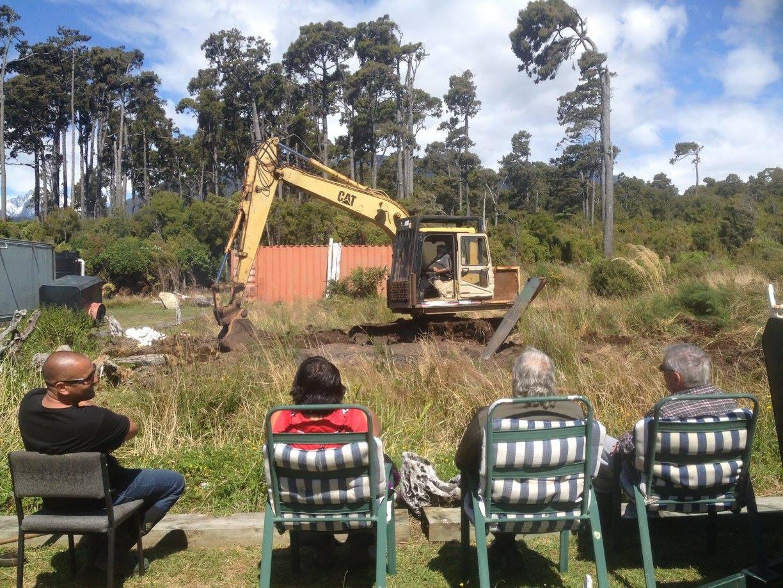Digging the hāngī pit South Westland style.