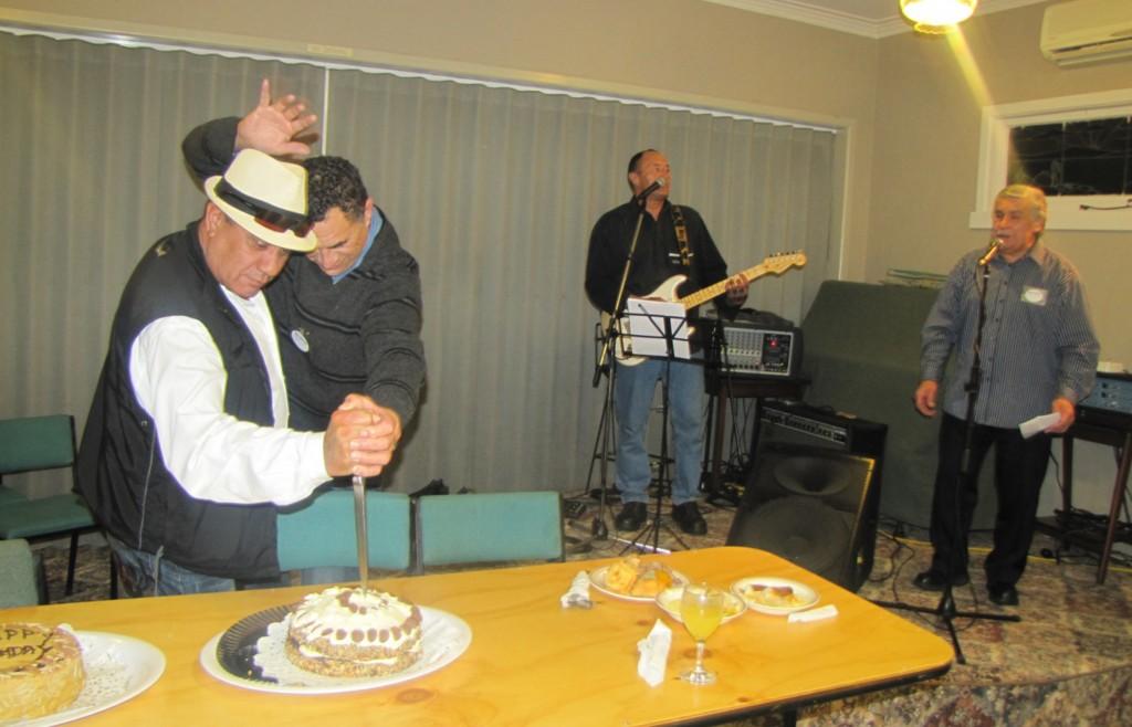Don Parkinson and Horomona Tau cutting our 1st birthday cake while celebrating their own birthdays.