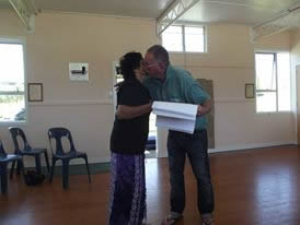 Dr Terry Ryan giving a copy of the whakapapa to Erena Rigby.