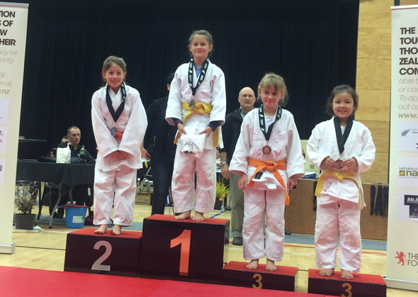 Esther on the first place podium at the nationals competition.