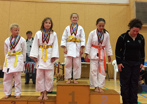 Esther on the first place podium.