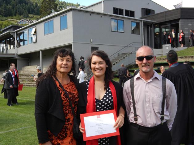 Eva with her proud parents, Waikohatu Scott and Will Keen.