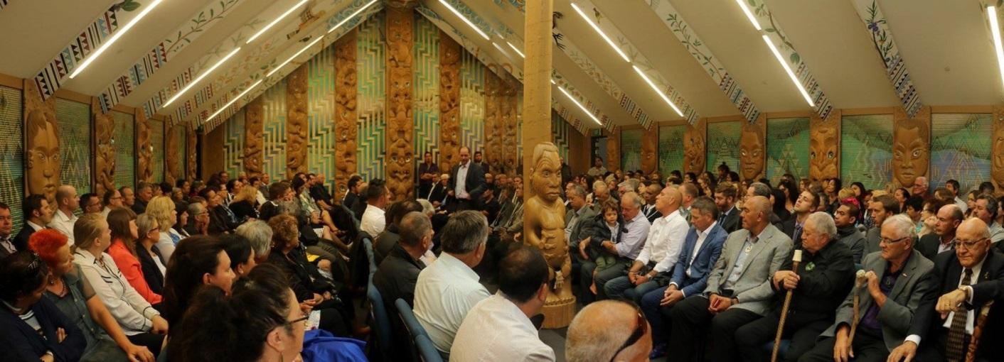 Everybody seated inside the whare tipuna.