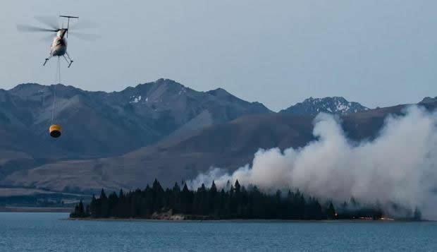 Fire raging on Motu Ariki Island, Lake Tekapō.