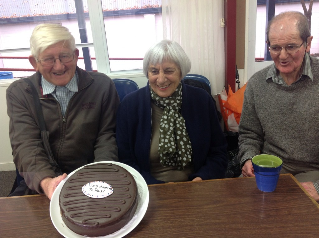 Fred Newton, Midge Hanrahan and Laurie Loper cutting a very special cake at our June hui.