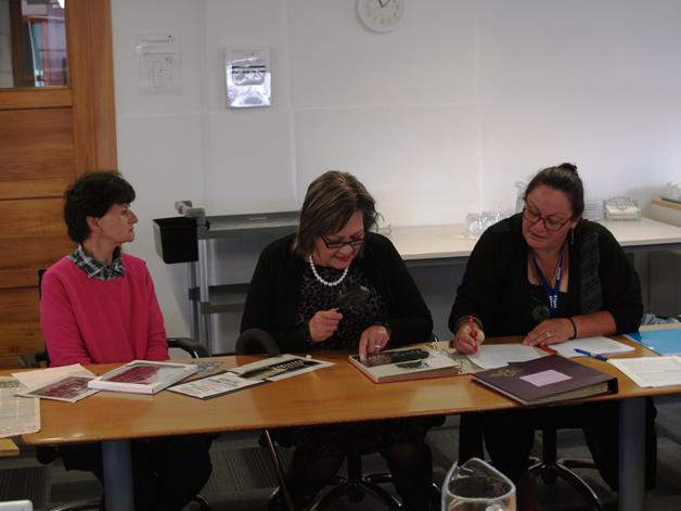 From left: Christine Denny, Maria Korako Tait and Karen Hubbard viewing and recording Te Waipounamu Māori Girls College images.