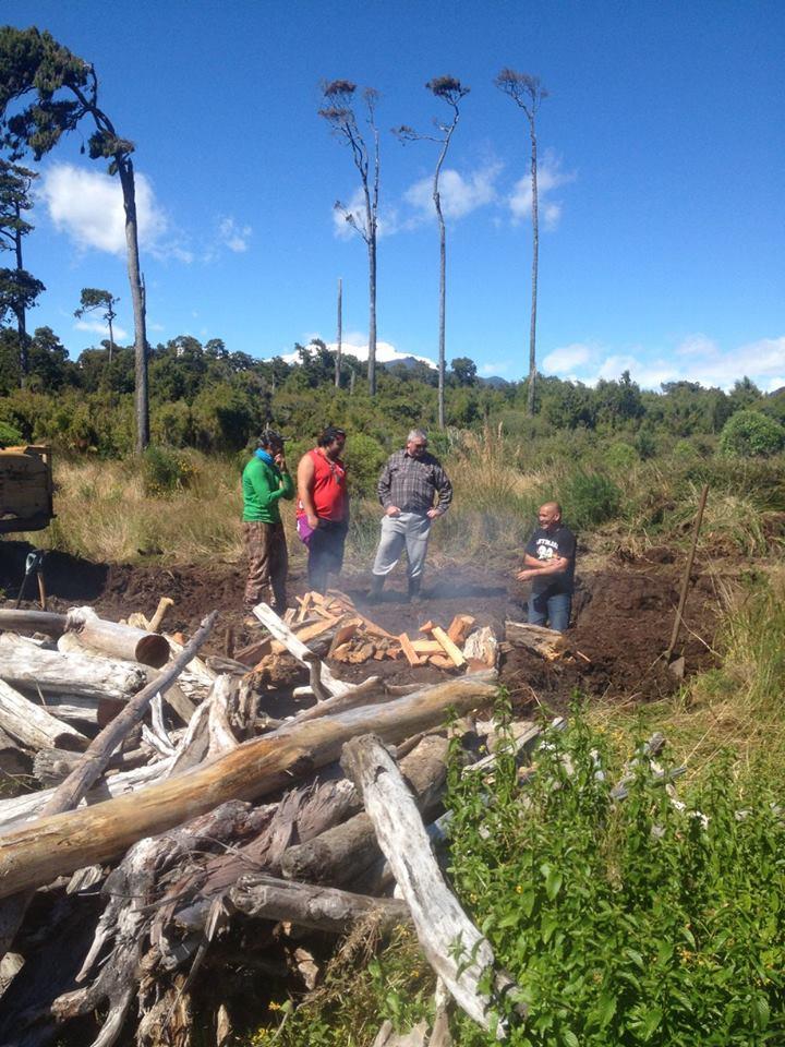 From left, Jeff Mahuika, Tutoko Wallace-Jones, Paul Madgwick and Corey Mahuika prepping the hāngī pit.