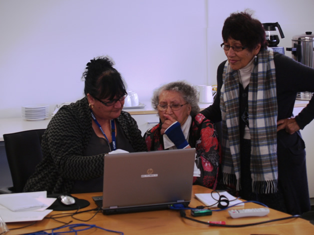 From left: Robyn Walsh, Rahui Denny and Dawn Kottier viewing and naming Te Waipounamu Māori Girls College images.