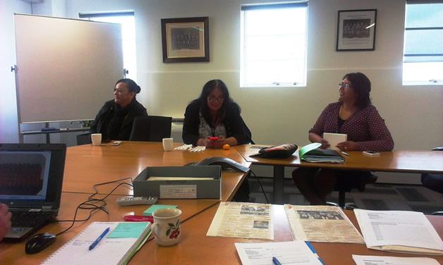 From left: Shana Ormsby, Jennifer Walsh and Rangimarie Takurua viewing and naming Te Waipounamu Māori Girls College images.