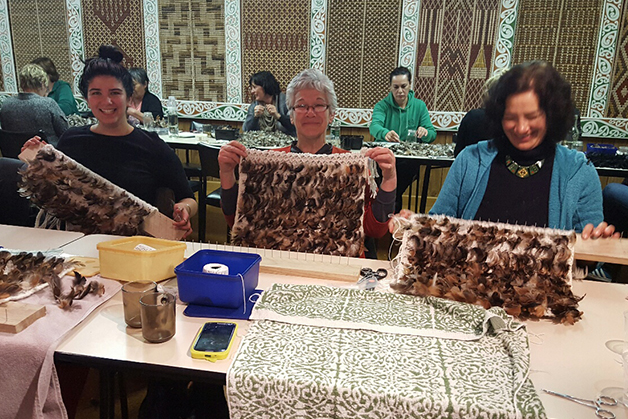 From left, Terina Stockwell, Louise Fowler and Eve Fowler-Stockwell working on their short korowai weaving.
