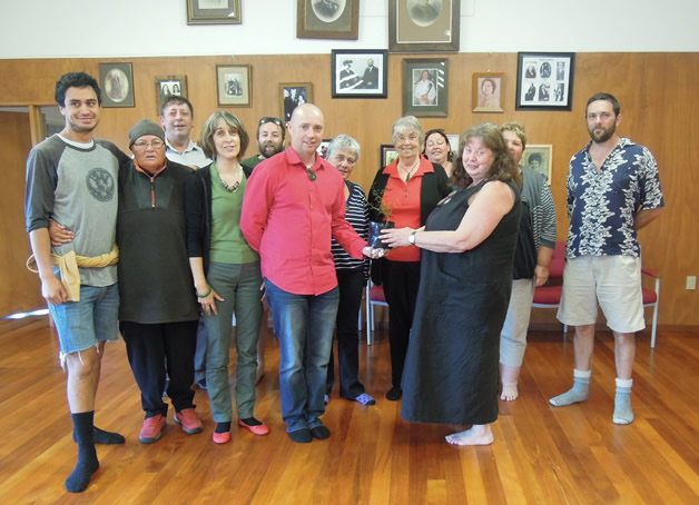 Gisele Laven and rūnaka members receiving a kōwhai from Dr. Graham Strong that he has grown from seed.