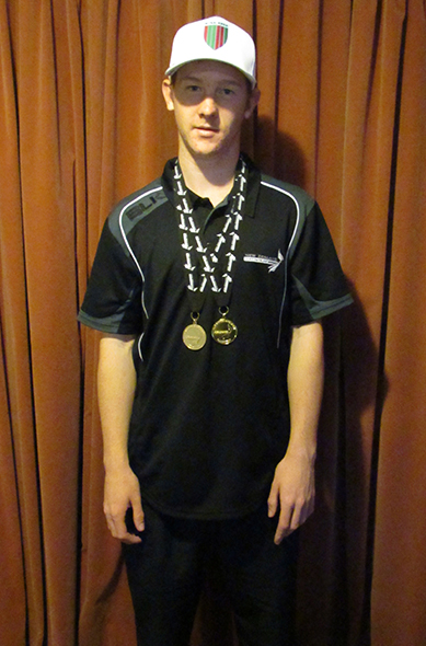 Gregory Hey with his winners medals.