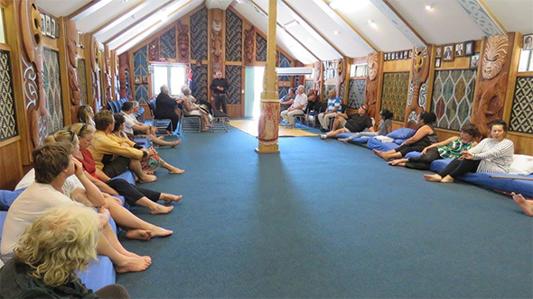 Guests listening to a kōrero from our chair, Paul Madgwick.