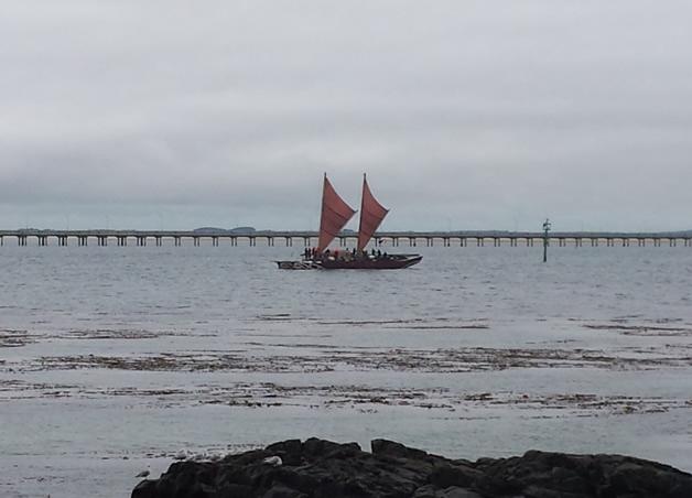 Haunui Waka coming up Bluff Harbour, opposite Morrison's Beach.