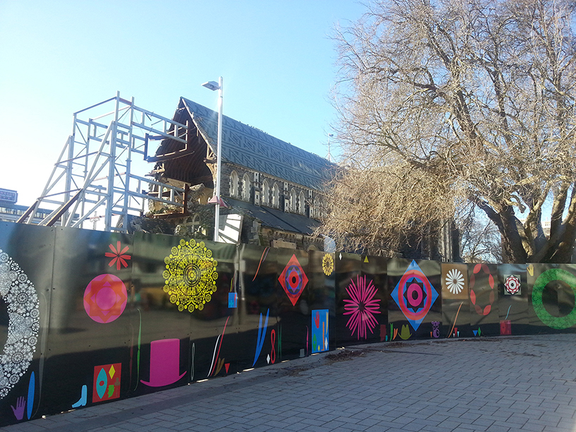 Heaphy's hoardings circling the cathedral.