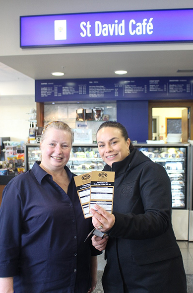 Jo Bain (left) and Victoria Campbell showing the KMK te reo ordering cards.