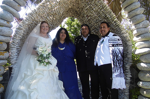 Johnny Te Wani with his parents Garry and Jacqui Te Wani and his new bride Michaela in the Takahanga archway.