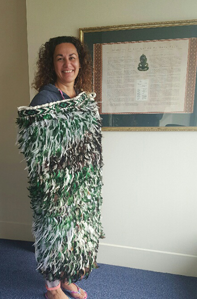Joyce Manahi wearing 'Ngā Roimata o Ranginui rāua ko Papatūānuku'.