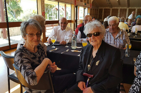 Judy Ryan, Margaret Bragg and other kaumātua at the Christmas lunch.