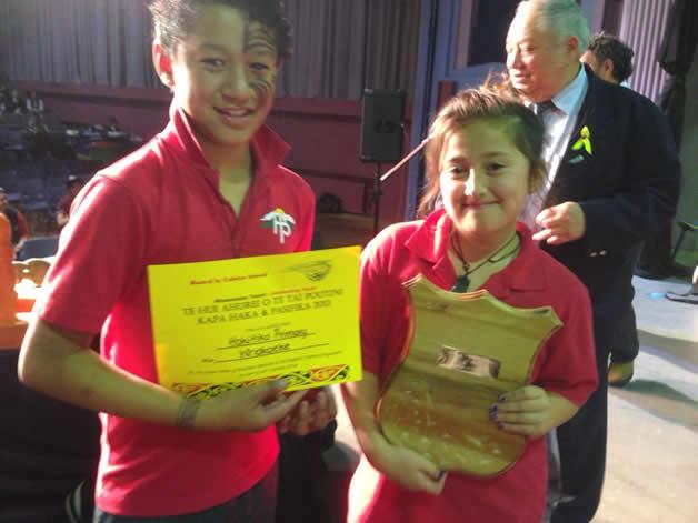 Kaea for Hokitika Primary Kapa Haka , Henare Mason and Aleigha Ngaamo with one of Hokitika's trophies.