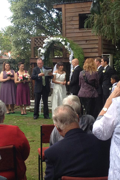 Kate and Dan surrounded by whānau at their wedding ceremony.