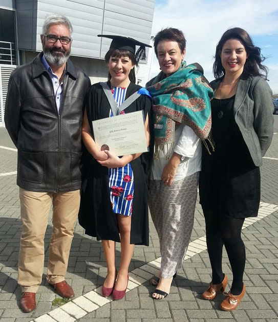 Kelly with her mātua, Greg and Wendy and tuakana, Rose.