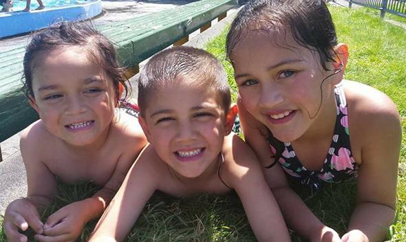 Kiani (centre) with his brother, Kaya and sister, Jury.