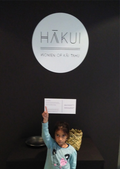 Kiritiaho in front of the Hākui exhibition sign.