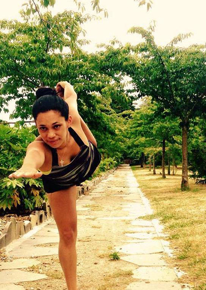 Letesha striking a yoga pose.