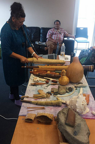 Mahina showing all her taonga and explaining how these items might have been used around Māori births.