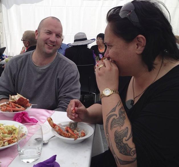 Manaia Cunningham and  Dione Payne enjoy the spoils of the hākari at the 2013 Hui-ā-Tau.